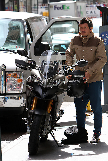 WWW.ACEPIXS.COM . . . . .  ....June 26 2012, New York City....Actor Orlando Bloom leaves his apartment and jumps aboard his Ducati on June 26 2012 in New York City....Please byline: Zelig Shaul - ACE PICTURES.... *** ***..Ace Pictures, Inc:  ..Philip Vaughan (212) 243-8787 or (646) 769 0430..e-mail: info@acepixs.com..web: http://www.acepixs.com