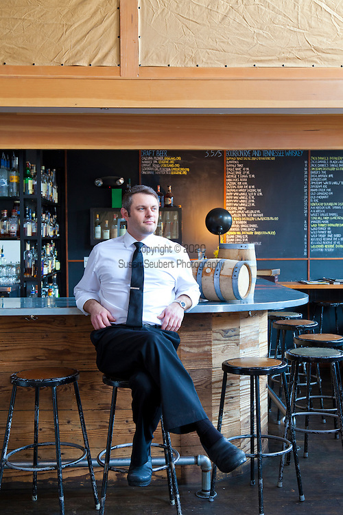 Barrel-aged cocktails made by Clyde Common's restaurant bartender, Jeffery Morgenthaler, in Portland, Oregon.  Pictured here is Jeffery at the bar in Clyde Common.
