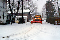 CLEARING SNOW OFF STREETS<br /> Garnerville, NY<br /> Snow plow removing snow in snow covered street.