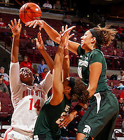 Ohio State Buckeyes guard Ameryst Alston (14) has her shot blocked by Michigan State Spartans center Madison Williams (40) during the first half of their NCAA basketball game at Value City Arena in Columbus, Ohio on January 26, 2014.  (Dispatch photo by Kyle Robertson)