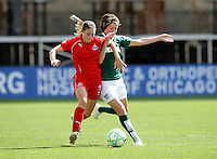 Washington Freedom defender Jill Gibeau (3) battles for the ball with Chicago Red Star forward Megan Rapinoe (8).  The Washington Freedom defeated the Chicago Red Stars 3-2 at Toyota Park in Bridgeview, IL on July 26, 2009.
