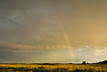 Rainbow at the end of a thunderstorm at sunset, Florence, Colorado.