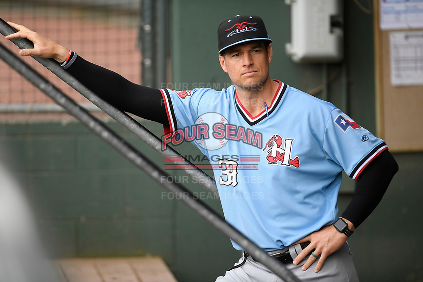 Manager Matt Hagen (39) of the Hickory Crawdads in the dugout before a game against the Greenville Drive on Wednesday, May 15, 2019, at Fluor Field at the West End in Greenville, South Carolina. Greenville won, 6-5. (Tom Priddy/Four Seam Images)