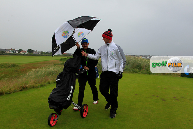 Sean Flanagan (Co. Sligo) and caddy Declan Reidy (Co. Sligo) on the 1st tee during the Semi-Finals of Matchplay in the North of Ireland Amateur Open Championship at Portrush Golf Club, Portrush on Friday 15th July 2016.<br /> Picture:  Thos Caffrey / www.golffile.ie