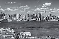 The Manhattan skyline as viewed over the Hudson River looking east from Weehawken, New Jersey on a summer afternoon.