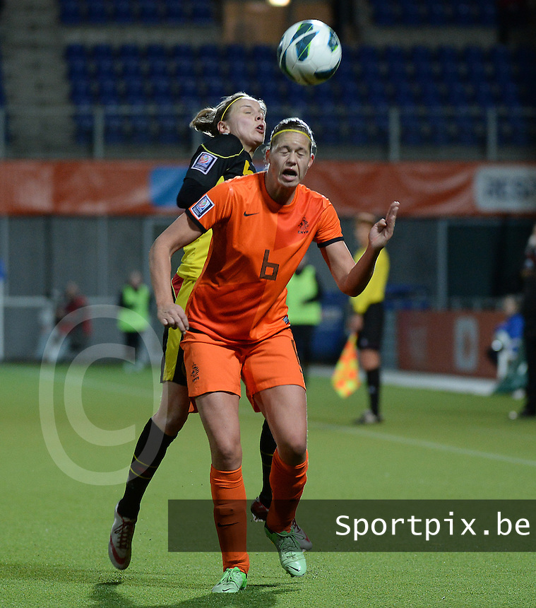20140212 - ZWOLLE , THE NETHERLANDS : duel pictured between Belgian Lorca Van De Putte and Dutch Anouk Dekker (6)  during the female soccer match between The Netherlands and Belgium , on the fifth matchday in group 5 of the UEFA qualifying round to the FIFA Women World Cup in Canada 2015 at Het Ijseldelta Stadion , Zwolle . Wednesday 12th February 2014 . PHOTO DAVID CATRY