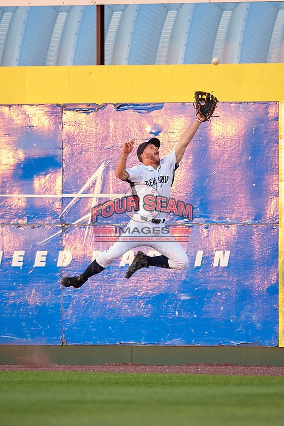 Binghamton Rumble Ponies right fielder Kevin Kaczmarski (14) jumps to try to make a catch during a game against the Altoona Curve on May 17, 2017 at NYSEG Stadium in Binghamton, New York.  Altoona defeated Binghamton 8-6.  (Mike Janes/Four Seam Images)