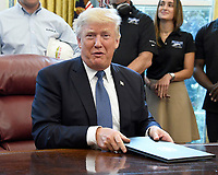 United States President Donald J. Trump gives a cryptic answer to a question posed by a reporter after signing the National Manufacturing Day Proclamation in the Oval Office of the White House in Washington, DC on Friday, October 6, 2017.<br /> CAP/MPI/CNP/RS<br /> &copy;RS/CNP/MPI/Capital Pictures