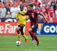 Clint Dempsey (8) of the USMNT sprints past Jason Morrison (7) of Jamaica during the game at RFK Stadium in Washington, DC.  The USMNT defeated Jamaica, 2-0.