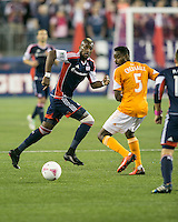 New England Revolution forward Dimitry Imbongo Boele (92) advances as Houston Dynamo midfielder Warren Creavalle (5) turns to intercept.  The New England Revolution played to a 1-1 draw against the Houston Dynamo during a Major League Soccer (MLS) match at Gillette Stadium in Foxborough, MA on September 28, 2013.