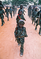 November 1975, Luanda, Angola --- Child soldiers of the The Popular Movement for the Liberation of Angola (MPLA) in Luanda. Upon independence from Portugal in 1975, Luanda and nominal government came under the one-party rule of MPLA. --- Image by © JP Laffont