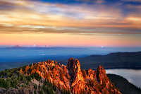 Sunrise from Paulina Peak with Paulina Lake and Three Sisters Mountain. Newberry National Volcanic Monument. Central Oregon