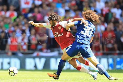 August 6th 2017, Wembley Stadium, London, England; FA Community Shield Final, Arsenal versus Chelsea; David Luiz of Chelsea fouls Mohamed Elneny of Arsenal