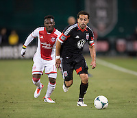 Dwayne De Rosario (7) of D.C. United sprints past Kalif Alhassan (11) of the Portland Timbers during a Major League Soccer match at RFK Stadium in Washington, DC.  The Portland Timbers defeated D.C. United, 2-0.