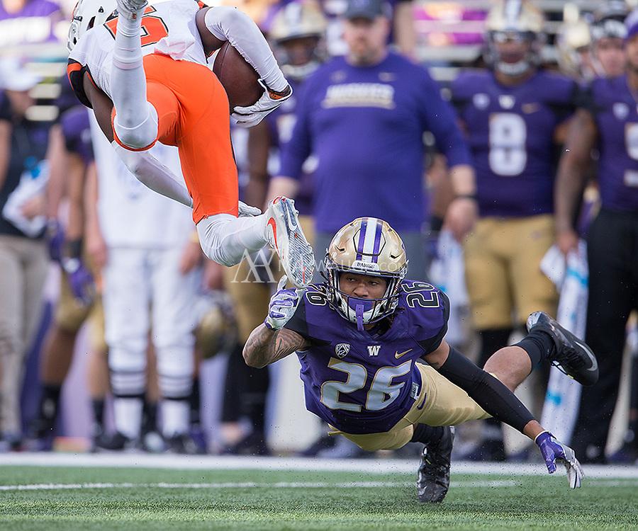 Sidney Jones makes a shoestring tackle.