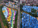 Pictured: These spectacular drone shots show a myriad of brightly coloured rooftops that look like a painting in the village Kampung Warna Warni in Indonesia. <br /> <br /> The local village has been transformed into a vivid artwork as daily life continues beneath the vivid colours of the houses. <br /> <br /> The pictures were taken by Razman Izzuddin on a recent trip to Malang, Surabaya in Indonesia using his drone.<br /> <br /> Please byline: Razman Izzuddin/Solent News<br /> <br /> © Razman Izzuddin/Solent News & Photo Agency<br /> UK +44 (0) 2380 458800