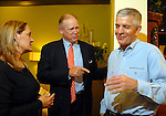 The Houston Chronicle's Jack Sweeney, center, jokes around with Jim McIngvale and his wife Linda during a grand opening party at the new Gallery Furniture location at 2411 Post Oak  Wednesday March 11, 2009. (Dave Rossman/For the Chronicle)