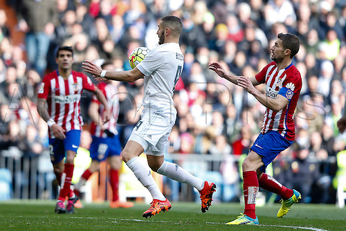 27.02.2016. Madrid, Spain.  Karim Benzema (9) Real Madrid and  Grabiel Fenandez Arenas (14) Atletico de Madrid during La Liga match between Real Madrid and Atletico de Madrid at the Santiago Bernabeu stadium in Madrid, Spain
