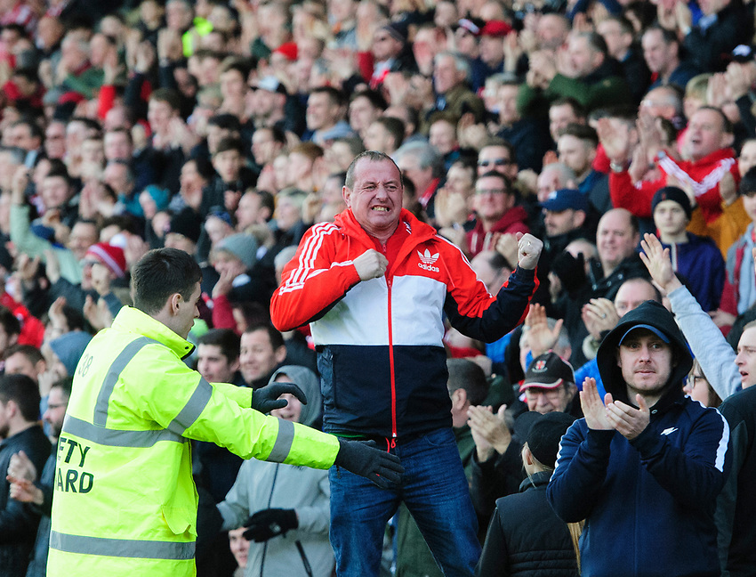 Lincoln City fans celebrate their teams goal, scored by Bruno Andrade<br /> <br /> Photographer Chris Vaughan/CameraSport<br /> <br /> The EFL Sky Bet League Two - Lincoln City v Stevenage - Saturday 16th February 2019 - Sincil Bank - Lincoln<br /> <br /> World Copyright © 2019 CameraSport. All rights reserved. 43 Linden Ave. Countesthorpe. Leicester. England. LE8 5PG - Tel: +44 (0) 116 277 4147 - admin@camerasport.com - www.camerasport.com