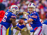 9 November 2014: Buffalo Bills quarterback Kyle Orton makes a hand-off to running back Anthony Dixon against the Kansas City Chiefs at Ralph Wilson Stadium in Orchard Park, NY. The Chiefs rallied with two fourth quarter touchdowns to defeat the Bills 17-13. Mandatory Credit: Ed Wolfstein Photo *** RAW (NEF) Image File Available ***