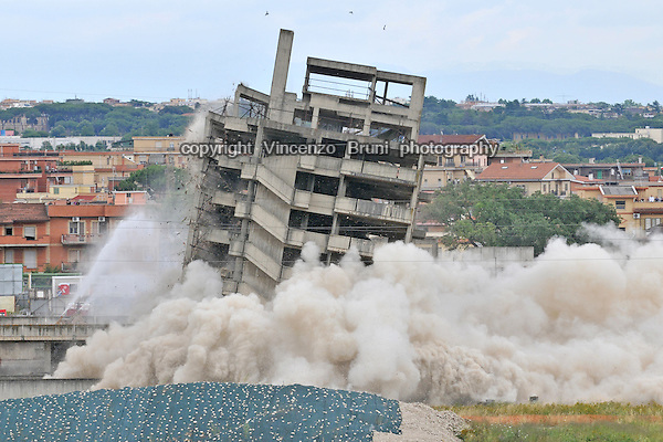 A 1980's unfinished building being demolished in Rome, June 2010.