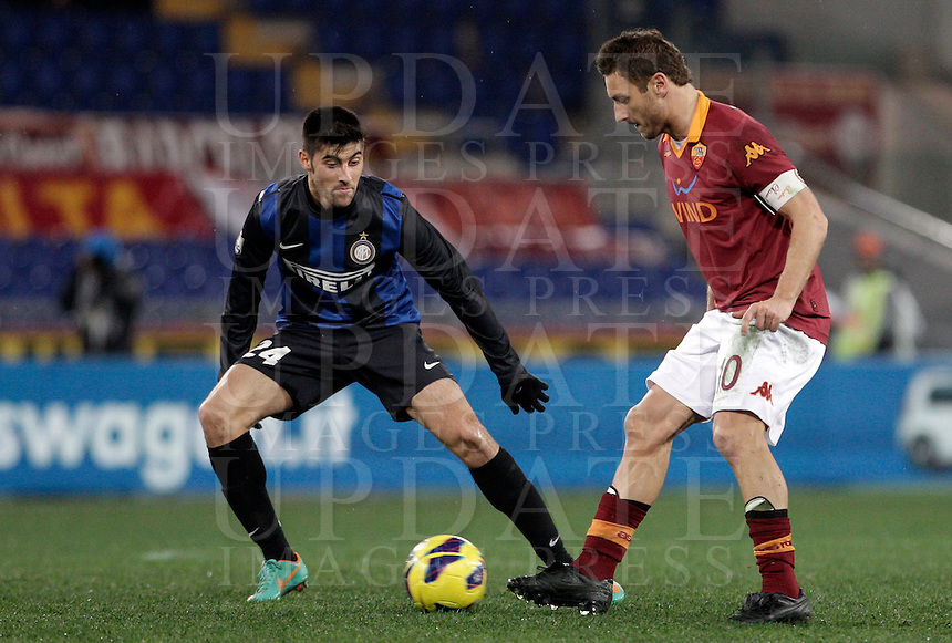 Calcio, semifinale di andata di Coppa Italia: Roma vs Inter. Roma, stadio Olimpico, 23 gennaio 2013..AS Roma forward Francesco Totti, right, is challenged by FC Inter midfielder Marco Benassi during the Italy Cup football semifinal first half match between AS Roma and FC Inter at Rome's Olympic stadium, 23 January 2013..UPDATE IMAGES PRESS/Riccardo De Luca