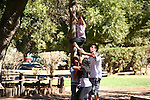 """An exercise in """"trust"""".<br />  <br /> In order to achieve that goal, the young girl above must have """"trust"""" that her friends below will support her."""