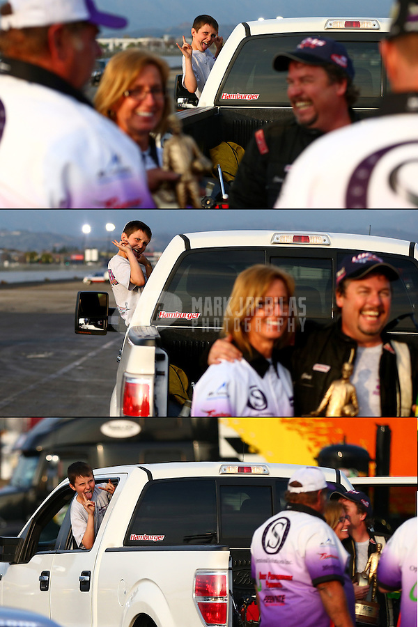 Feb 9, 2014; Pomona, CA, USA; Kace Rhoades photo bombs the celebration after NHRA top alcohol dragster driver Chris Demke won the Winternationals at Auto Club Raceway at Pomona. Mandatory Credit: Mark J. Rebilas-