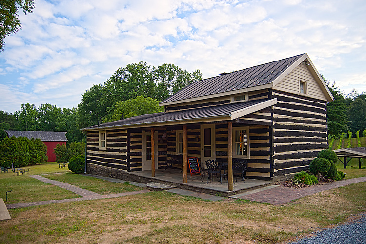 The tasting room and kitchens at Paradise Springs Winery (Clifton VA) are housed in a log cabin that dates from the early 1800s, renovated in 1955 by a protege of Frank Lloyd Wright.