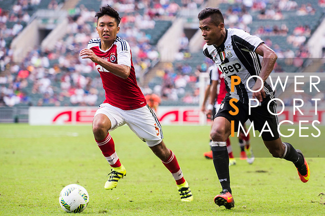South China's player Chak Ting Fung  contests the ball against Juventus' player Alex Sandro during the South China vs Juventus match of the AET International Challenge Cup on 30 July 2016 at Hong Kong Stadium, in Hong Kong, China.  Photo by Marcio Machado / Power Sport Images