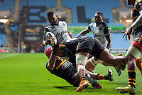Niko Matawalu of Bath Rugby is tackled to ground. European Rugby Champions Cup match, between Wasps and Bath Rugby on December 13, 2015 at the Ricoh Arena in Coventry, England. Photo by: Patrick Khachfe / Onside Images