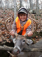 Courtesy photo<br /> SEVEN-POINT BUCK<br /> Brody Roland Reynolds (cq) , 7, of Springdale shows a 7-point buck he shot Nov. 7, 2015 during the statewide youth deer hunt. He and his dad, Bradley Reynolds, hunted on the family's land near Witter.