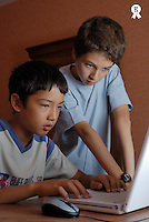 Two boys (10-12) using laptop, close-up (Licence this image exclusively with Getty: http://www.gettyimages.com/detail/200476761-002 )