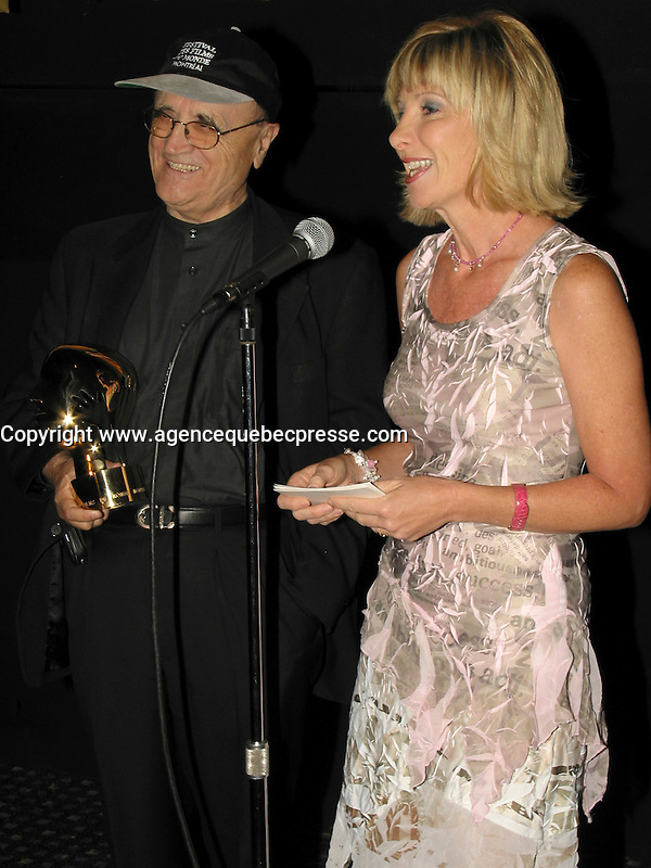 Montreal (Qc) CANADA<br /> Serge Losique (L) present an achievement award to producer Denise Robert (L) during the 2003 World Film Festival <br /> Photo (c) 2003, Pierre Roussel / Images Distribution