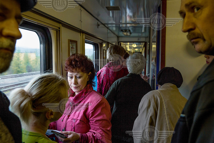 People line up in the corridor of the Matvei Mudrov train to register before going to see a doctor. <br /> <br /> The Matvei Mudrov train is a medical train operated by Russian Railways along the course of the Baikal Amur Magistral (Baikal-Amur Mainline, or BAM) railway line. Named after a famous 19th century Russian physician, the train employs around 15 doctors who make about 10 trips a year, each lasting two weeks. Along the way they deliver essential medical services to people living in remote villages along the 4,324 km long BAM railway. Though not equipped to carry out surgical procedures the train has heart monitors, ultrasound and x-ray machines to deliver diagnosis.