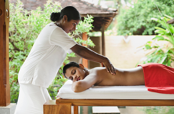A woman receives a Deep Tissue Massage at the Sahana Spa, Saman Villas, Aturuwella, Bentota, Sri Lanka. This massage treatment focuses on the deeper layers of muscle tissues and aims to release toxins and tension from the body using slow strokes as well as deep finger and elbow pressure on the stressed muscle areas.