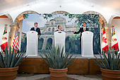 Guadalajara, Mexico - August 10, 2009 -- United States President Barack Obama,  Canada's Prime Minister Stephen Harper,  and Mexico's President Felipe Calderon, take part in the press conference at the Cabanas Cultural Center during the North American Leaders' Summit in Guadalajara, Mexico, August 10, 2009. .Mandatory Credit: Pete Souza - White House via CNP