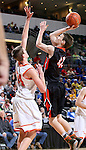 SIOUX FALLS, SD - MARCH 19: Peyton Carr #42 from Huron shoots over Cole Benson #34 from Washington in the second half of their quarterfinal game Thursday afternoon during the Boys State AA Basketball Tournament at the Denny Sanford Premire Center in Sioux Falls, SD. (Photo by Dave Eggen/Inertia)
