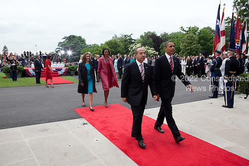 United States President Barack Obama and First Lady Michelle Obama walk towards the South Portico entrance of the White House with Mexican President Felipe Calderón and his wife, Mrs. Margarita Zavala, following the State Arrival ceremony on the South Lawn of the White House, Wednesday, May 19, 2010..Mandatory Credit: Pete Souza - White House via CNP