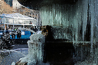 New York, United States. January 23, 2013. .A fountain is seen partially covered with ice during a cold Temperature under zero in New York City  -- . Photo by Eduardo Munoz Alvarez / VIEWpress.