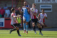 Jordan Bowery of Leyton Orient and Daniel O'Shaughnessy of Cheltenham battle for possession during the Sky Bet League 2 match between Cheltenham Town and Leyton Orient at the LCI Rail Stadium, Cheltenham, England on 6 August 2016. Photo by Mark  Hawkins / PRiME Media Images.