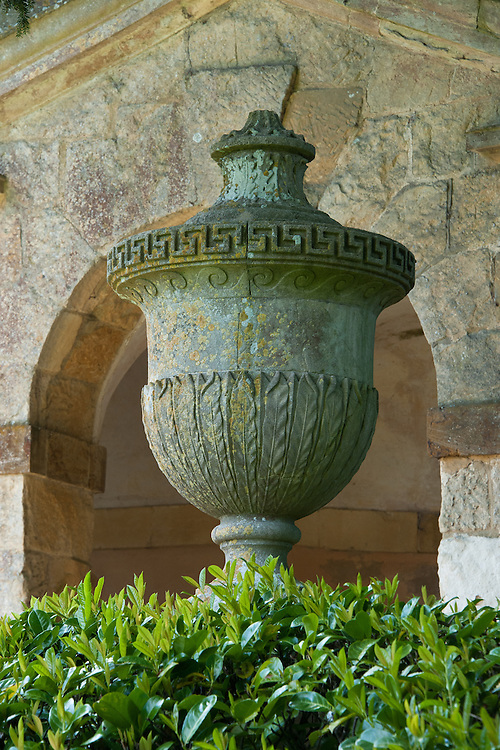 A stone urn at the side of The Praeneste, a seven-arched  arcade by William Kent (1738-40), Rousham House and Garden.