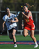 Cara Urbank #18 of Sacred Heart, right, races downfield under pressured by Katie Hudson #21 of Cold Spring Harbor during a non-league varsity girls lacrosse game at Cold Spring Harbor High School on Friday, Apr. 1, 2016. Cold Spring Harbor won by a score of 11-9.