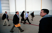 United States President George W. Bush, accompanied by Deputy Chief of Staff Joe Hagin and Dan Bartlett, Counselor to the President, arrives at Andrews Air Force Base Monday night, June 12, 2006, where he boarded Air Force One for an unannounced flight to Iraq. <br /> Mandatory Credit: Eric Draper / White House via CNP
