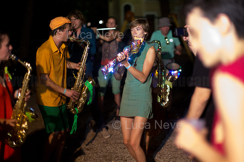 Rome, 29/06/2018. Today, the &quot;5ᵃ Sbandata Romana&quot; took place in the streets of Centocelle district in Rome. This year, this popular and gratuitous event of Music without barriers (and borders) saw 21 bands &ndash; 500 musicians &ndash; from Austria, France, Germany, United States, Milan, Bologna, Florence and Rome. From the organisers website: &lt;&lt;La Sbandata is a big popular festival dedicated to Music which has got the Street Bands as protagonists: conceived from below and organized by the host Band, along with the local, city institutions and organizations which have accompanied it in recent years. From the 2000s, it takes place annually in different cities: Milan, Bologna, Florence, Rome, Paris, Brest, Munich, Graz, and also overseas with the Honk Festival held in Somerville, New York and Rio de Janeiro. During the Festival days the Bands invade squares and prefixed places with the aim of activating a non-stereotyped socialization and, above all, without barriers! The abolition of every element of separation between musicians and spectators creates a unique interaction, an overwhelming alchemy, made of spontaneity and human warmth. La Sbandata is also a moment of comparison between the Bands, different for training and experiences but which share values, battles, utopias and express themselves through the common language of music, a formidable tool of struggle and protest, of social commitment and socialization [&hellip;]&gt;&gt;.<br /> For this reportage I would like to thank all the Music Bands, the amazing People of Centocelle, and in particular: Eleonora, Giulia, Greta, Kamal, Matteo, Nikolas, Riccardo, Timur: Grazie!<br /> <br /> For more info please click here: https://www.titubanda.it/ &amp; https://www.facebook.com/Titubanda/ &amp; https://bit.ly/2KFguge &amp; https://bit.ly/2z212q8 (Video Presentation - Sub in Eng) https://youtu.be/Q4rEz7QZfdw