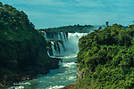 Iguazu Falls National Park in Argentina at right with Brazil at left.  A UNESCO World Heritage Site.  Pictured is the Devil's Throat or Garganta del Diablo, the largest of the falls at Iguazu and the border between the two countries runs through this waterfall.