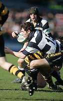 Wallace fullback Philip Wilson is halted during this attack during the Northern Bank Schools Cup Final at Ravenhill. Result Wallace 0pts R.B.A.I. 15pts.