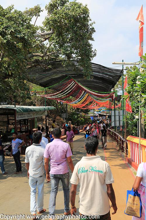 People walking to and from Koneswaram Kovil Hindu temple, Trincomalee, Sri Lanka, Asia