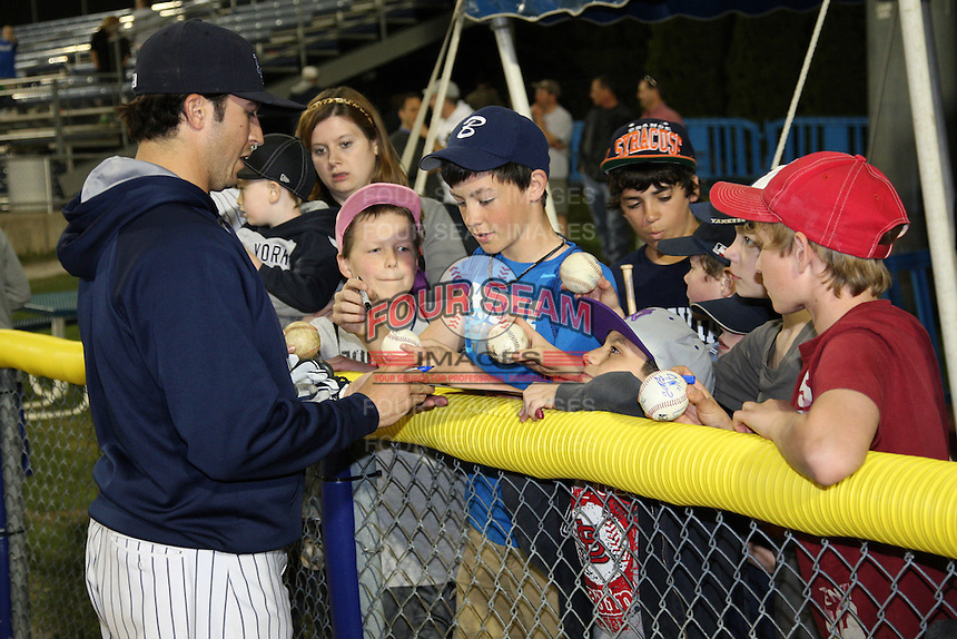 Empire State Yankees outfielder Raymond Kruml #51 signs autographs after a game against the Norfolk Tides in the first ever Triple-A contest to be held at Dwyer Stadium on April 20, 2012 in Batavia, New York.  (Mike Janes/Four Seam Images)