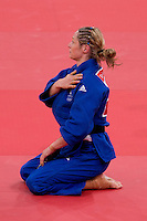 30.07.2012. London, England. Britains Sarah Clark (GBR) is beaten by Automne Pavie (FRA) in the Womens 57kg Elimination Round of 32 during the Judo Preliminaries on Day 3 of the London 2012 Olympic Games at ExCeL.